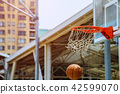 A motion of basketball swishing through the hoop 42599070