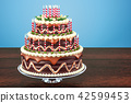 Chocolate Birthday Cake with candles on stand 42599453