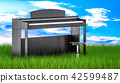 Digital piano with chair in green grass 42599487