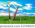 Harp in green grass against blue sky 42599624