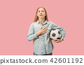 Fan sport woman player holding soccer ball isolated on pink background 42601192