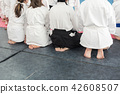 People in kimono and hakama on martial arts training 42608507