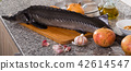 Uncooked raw sturgeon at plate laying on table 42614547
