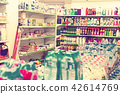 Chemistry department with detergents on shelves 42614769