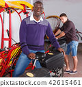 African-American man offering cycle rickshaw service 42615461