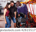 Pedicab driver negotiating with couple 42615517