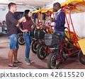 Cheerful people planning trip on pedicab 42615520
