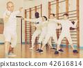 instructor, exercising, gloves 42616814