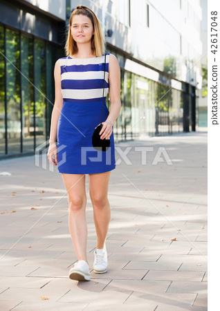 Young stylish girl strolling through city streets 42617048
