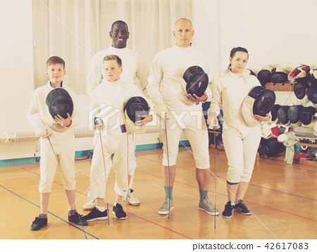 Portrait of adult and teen fencers 42617083