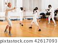 instructor, exercising, gloves 42617093