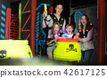 Kids with parents during lasertag game 42617125