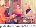 female friends sitting with lotto 42617179