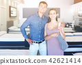 Portrait of family in mattress store 42621414