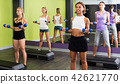Girls exercising with dumbbells 42621770