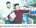 Young couple choose toilet paper in the shop 42622513