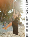 girl swinging on a swing 42624389