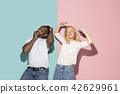 The squint eyed couple with weird expression on blue and pink studio 42629961