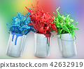 different colors splashing from paint buckets 42632919