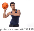 Teen sportsman with sportswear playing basketball. White backgro 42638439