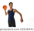 Teen sportsman with sportswear playing basketball. White backgro 42638441