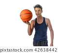 Teen sportsman with sportswear playing basketball. White backgro 42638442