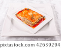Italian Food. Hot tasty Classic Lasagna with bolognese sauce on white plate. 42639294