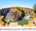 Victoria Falls on Zambezi River. Dry season. Border between Zimbabwe and Zambia, Africa. Fisheye 42639630