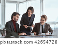 Businesspeople at office working together signing agreement 42654728