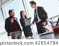 Businesspeople at office working together standing men talking t 42654784