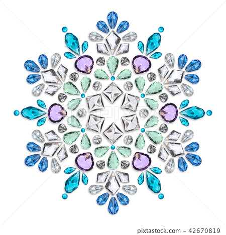 Creative layout of jewelry. The mandala is made of different gemstones on white 42670819