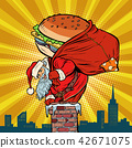 Santa Claus with a Burger climbs into the chimney. Food delivery 42671075