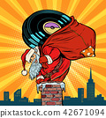 Santa Claus with vinyl records climbs into the chimney 42671094