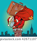 Santa Claus with a suitcase climbs into the chimney 42671107