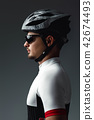 portrait of cyclist wearing helmet 42674493
