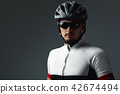 portrait of cyclist wearing helmet 42674494