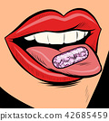 oral pill on a woman tongue 42685459