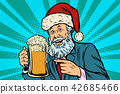 Old man in a Christmas cap with a mug of foam beer 42685466