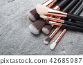 Various makeup brushes isolated 42685987