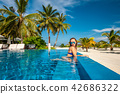 Woman at beach pool in Maldives 42686322