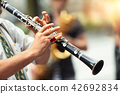 Detail of a street musician playing the clarinet 42692834