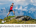 A skyrunner athlete man trains  42693004