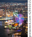 A luxurious passenger boat moored at Osaka Port and a night view of Bayside and a Ferris wheel of Rainbow (vertical composition) 42693015