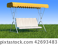 Garden swing with canopy in the green grass 42693483
