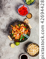 Stir fry with prawns, vegetables, soy sause and sesame 42694428