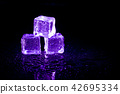 Purple ice cubes reflection on black background. 42695334
