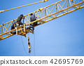 Group of labour working on the tower crane. 42695769