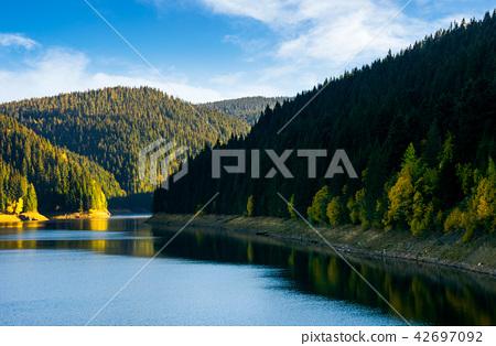 storage reservoir in mountain at sunrise 42697092