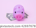 Pink Piggy bank on soft pink background with USD  42697678