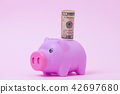 Pink Piggy bank on soft pink background with USD  42697680